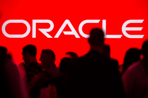18 Mar 2014, San Francisco, California, USA --- People gather prior to the start of a keynote speech at the All Things Oracle OpenWorld Summit in San Francisco, California in this file photo from September 24, 2013. Oracle Corp on Tuesday said new software sales and Internet-based software subscriptions in its fiscal third quarter roes 4 percent from a year earlier. REUTERS/Jana Asenbrennerova/Files (UNITED STATES - Tags: SCIENCE TECHNOLOGY BUSINESS) --- Image by © JANA ASENBRENNEROVA/Reuters/Corbis